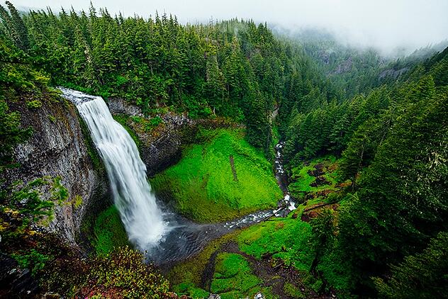 Waterfall plunging into forest canyons and rivers