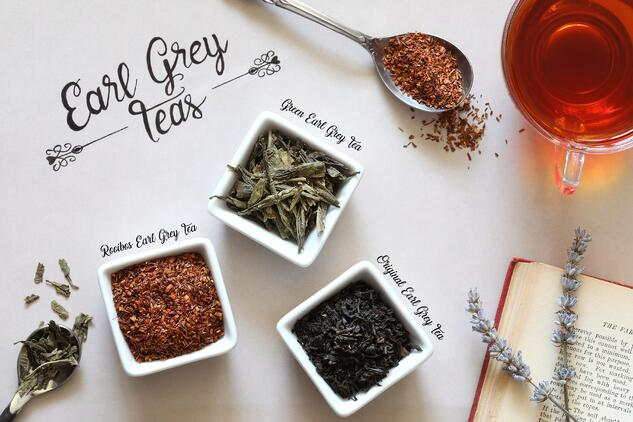 Different types of earl grey tea laying out in ceramic containers, loose-leaf brews