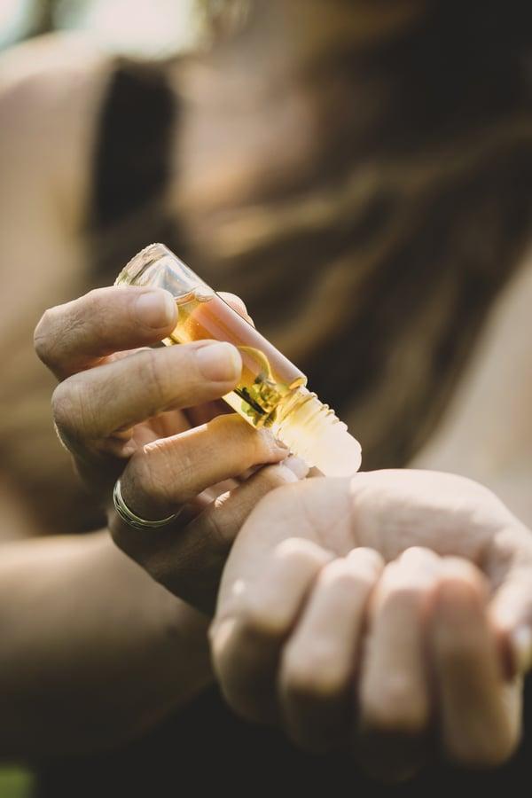 Applying a perfume on the wrist