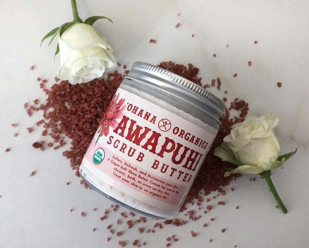 Awapuhi Butter Scrub Butter Jar sitting on Red alaea salt and white roses