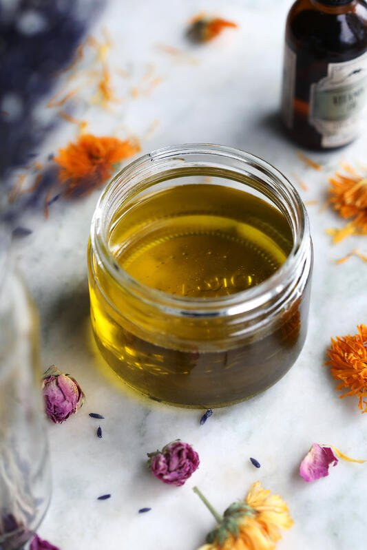 Infused massage oil for baby with dried flowers.