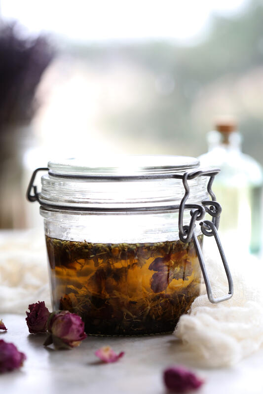Flowers infusing into oil for baby massage.