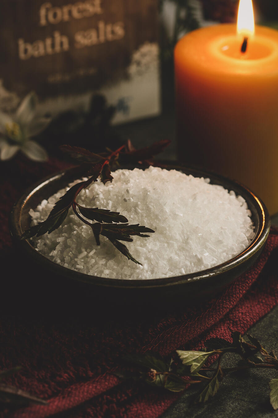 Bath salts in a bowl with a candle.