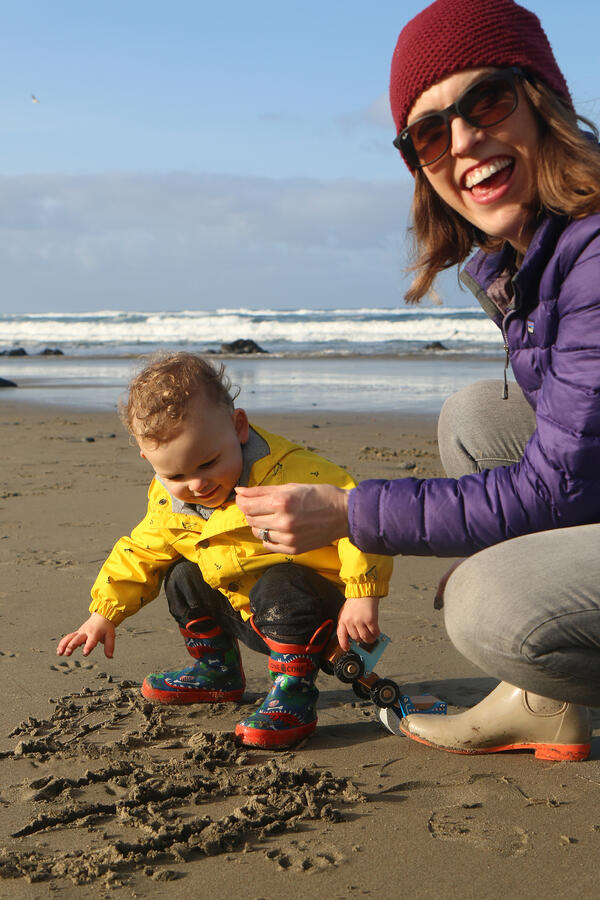 Fun day at the beach with mother and child.