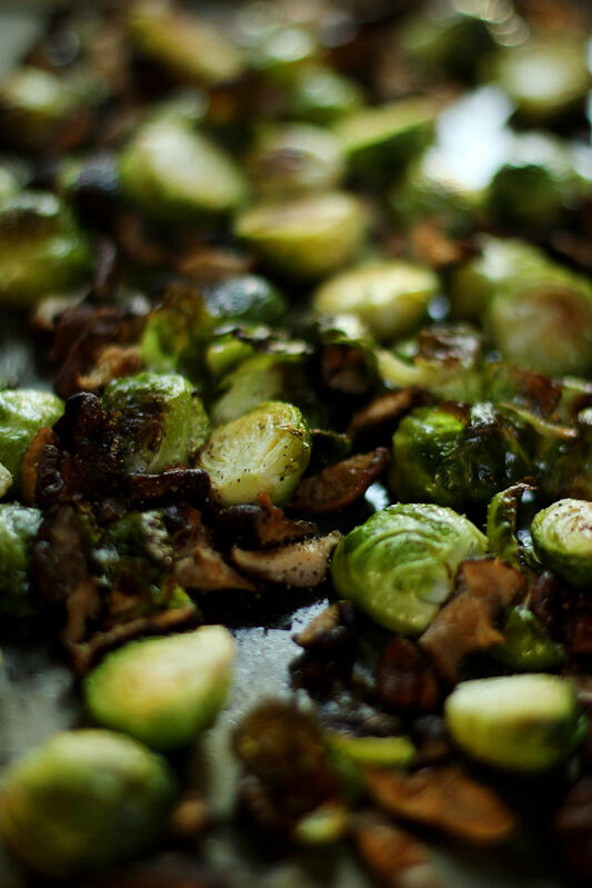 Garlic-infused olive oil gives roasted brussels sprouts a delicious aroma and flavor. Add spices and shiitake mushrooms for a decadent side dish.