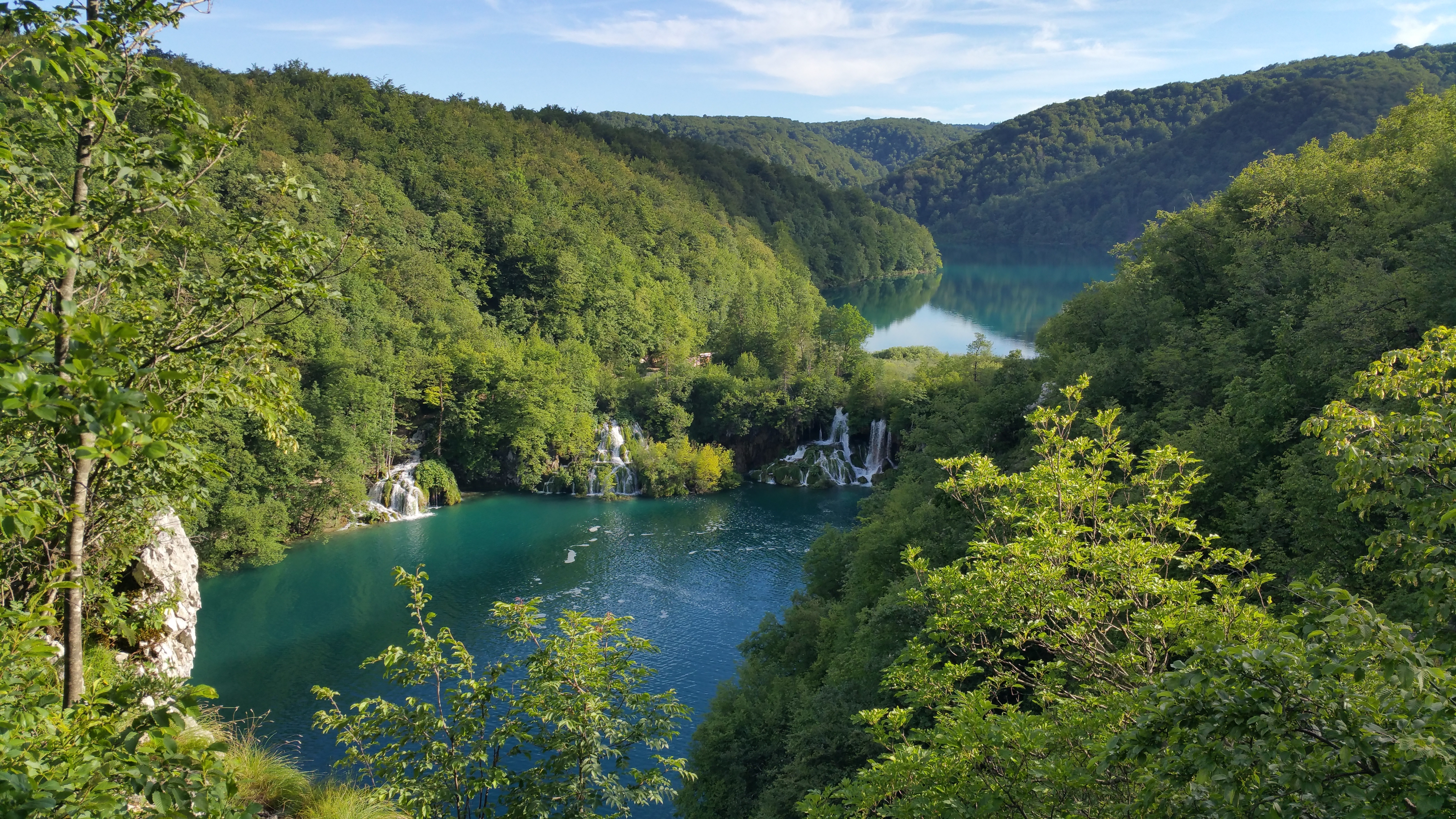 Lush forests with canyon showing turquoise-colored river in Budapest