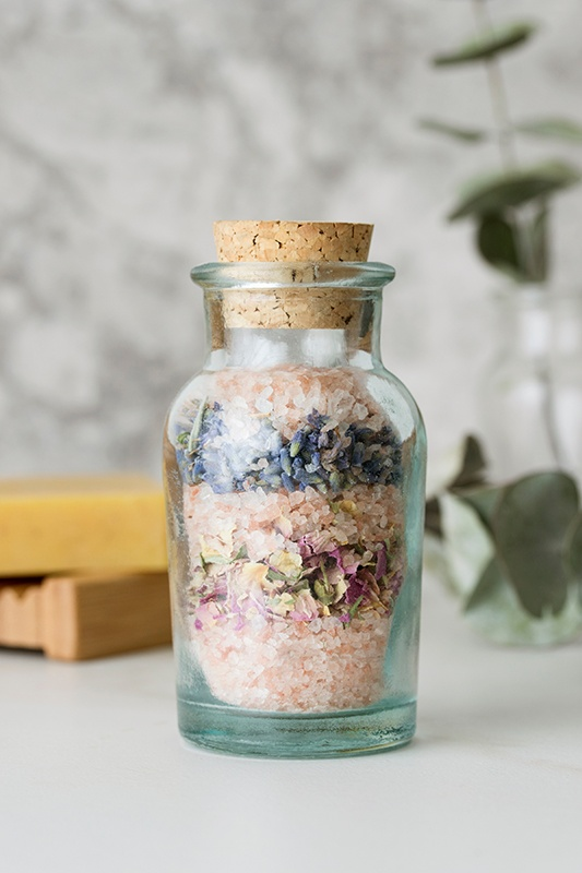 Cork bottle with colorful homemade bathsalts