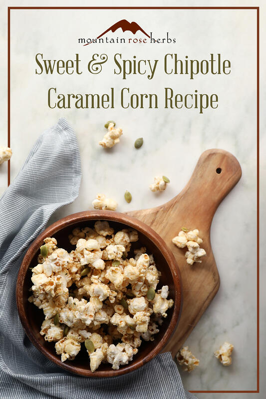 Pinterest link to Mountain Rose Herbs. A bowl of homemade caramel corn with pumpkin seeds, hemp seeds, and pumpkin pie spice. Perfect for fall snacking, sweet and spicy with chipotle powder.