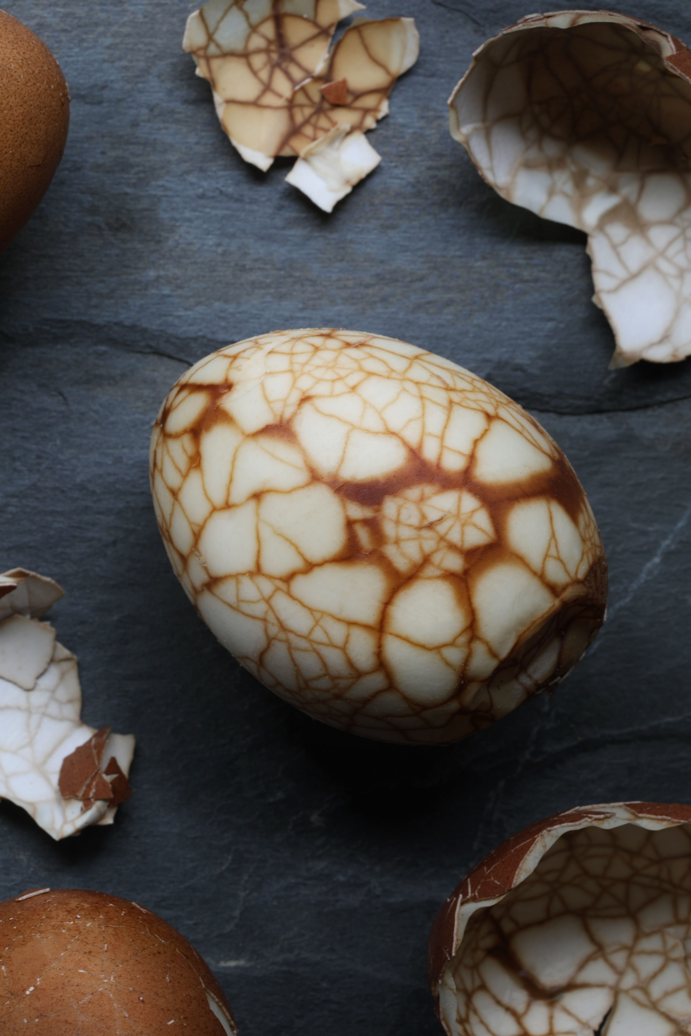 Close up photo of marbled tea egg showing brown lines along cracked area