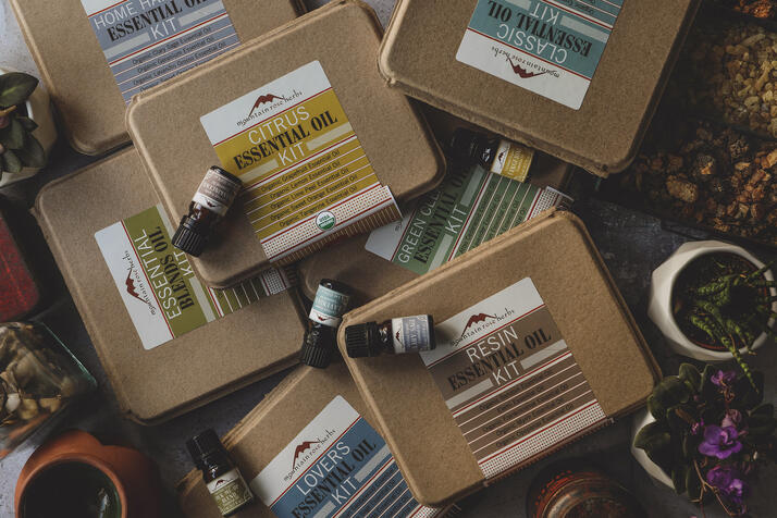 several essential oil kits in sustainable packaging