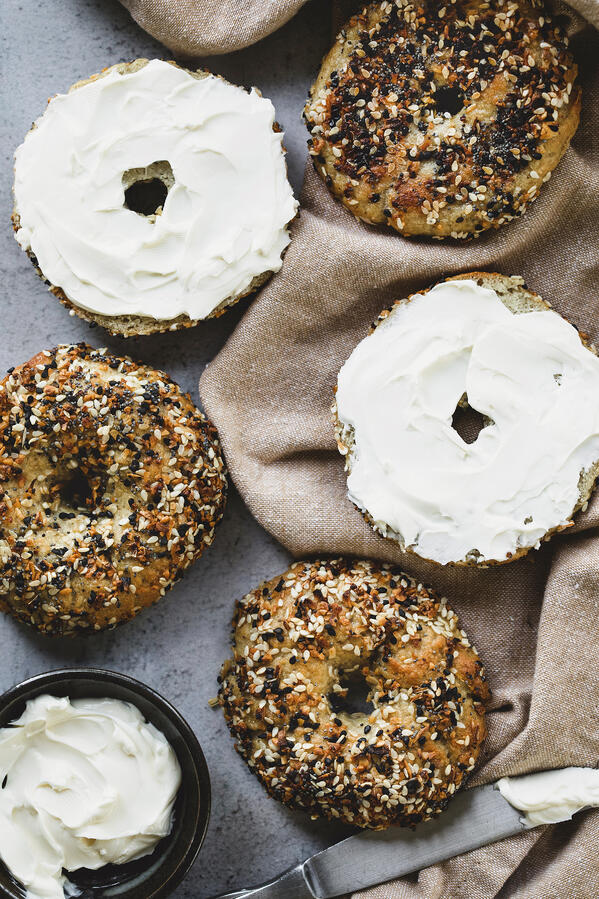 Homemade gluten free everything seed mix bagels with cream cheese.
