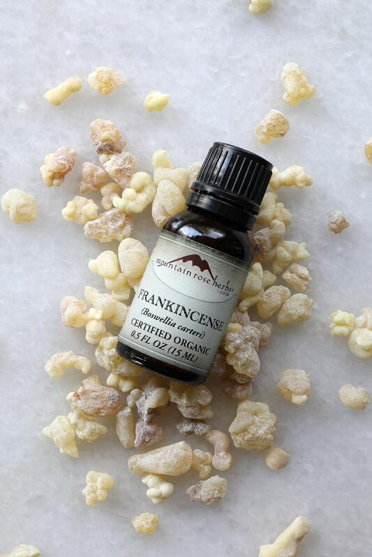 1/2 oz. bottle of Mountain Rose Herbs essential oil on counter with frankincense resin