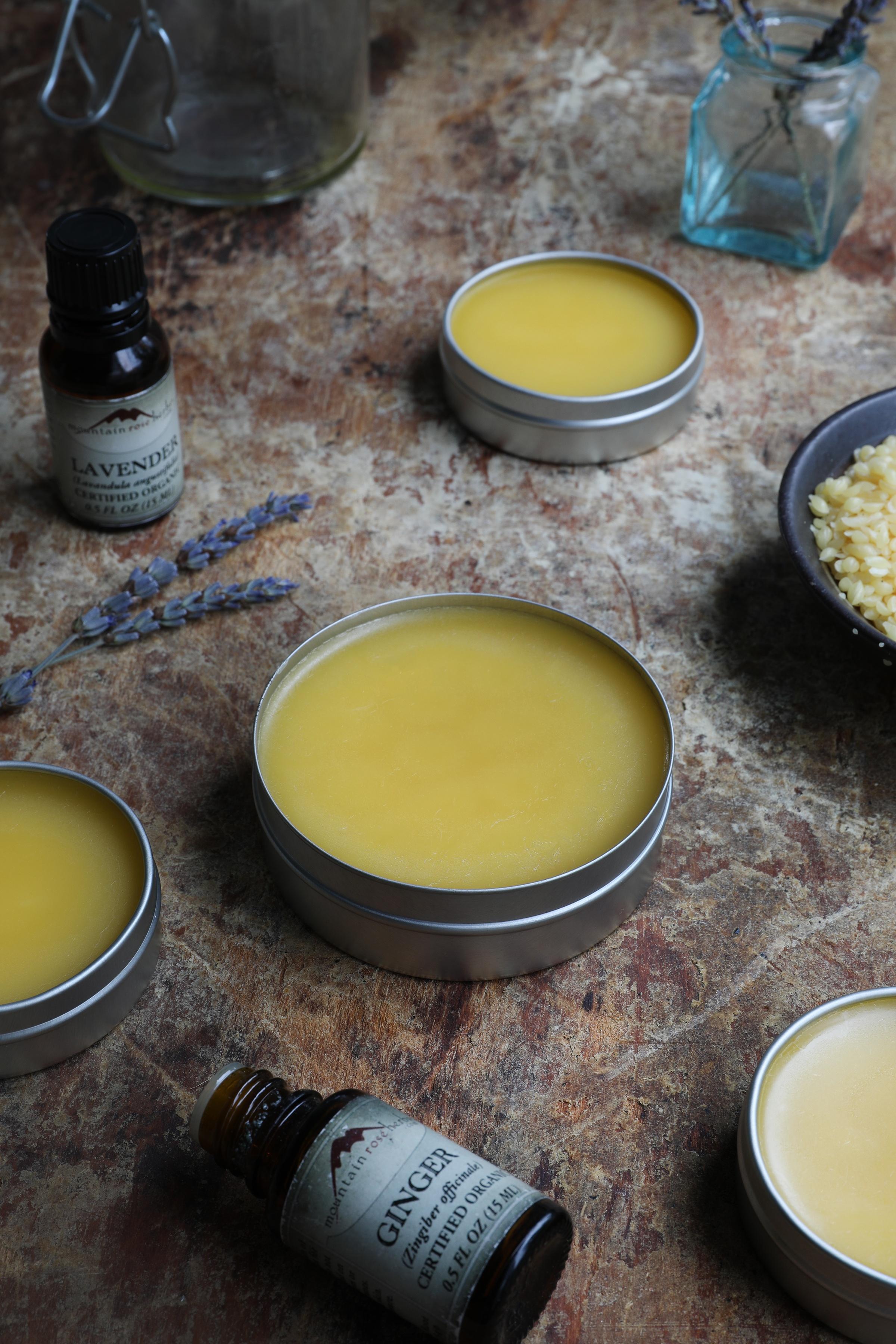 Tin jars filled with hardened arnica lavender salve
