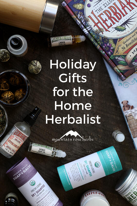 Holiday gifts for the home herbalist include flowering teas, aromatherapy picks like essential oil roll-ons and aroma sprays, body care products like dry herbal shampoo and scrub butters, and books on herbalism.