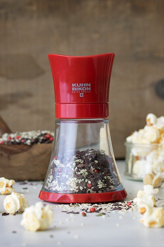 Kuhn Rikon spice grinder with sesame seeds and dulse flakes next to popcorn kernals