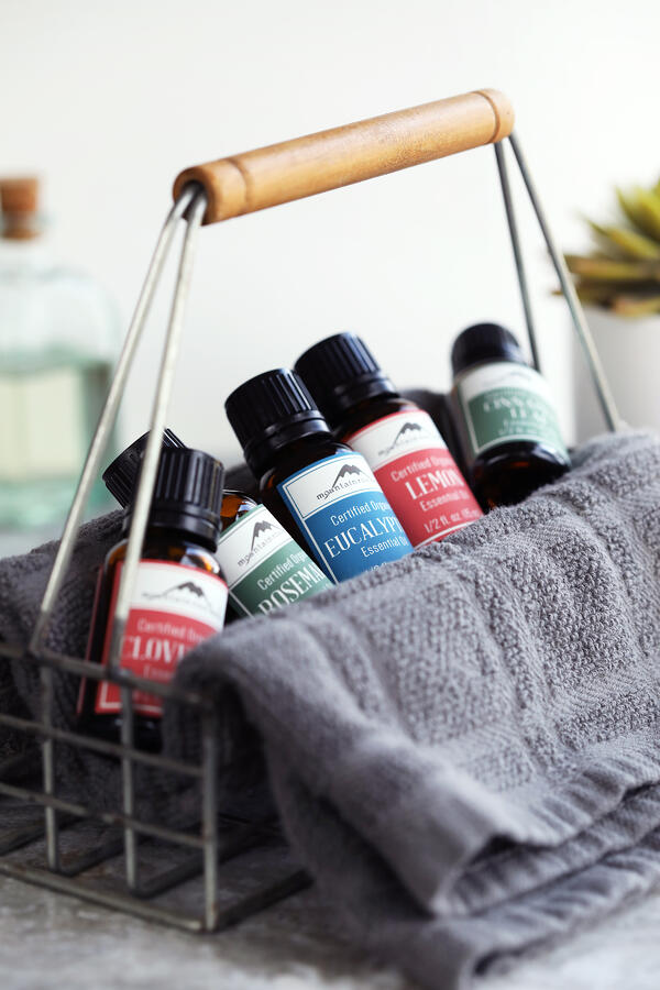 Basket of organic essential oils for DIY four thieves blend from Mountain Rose Herbs.
