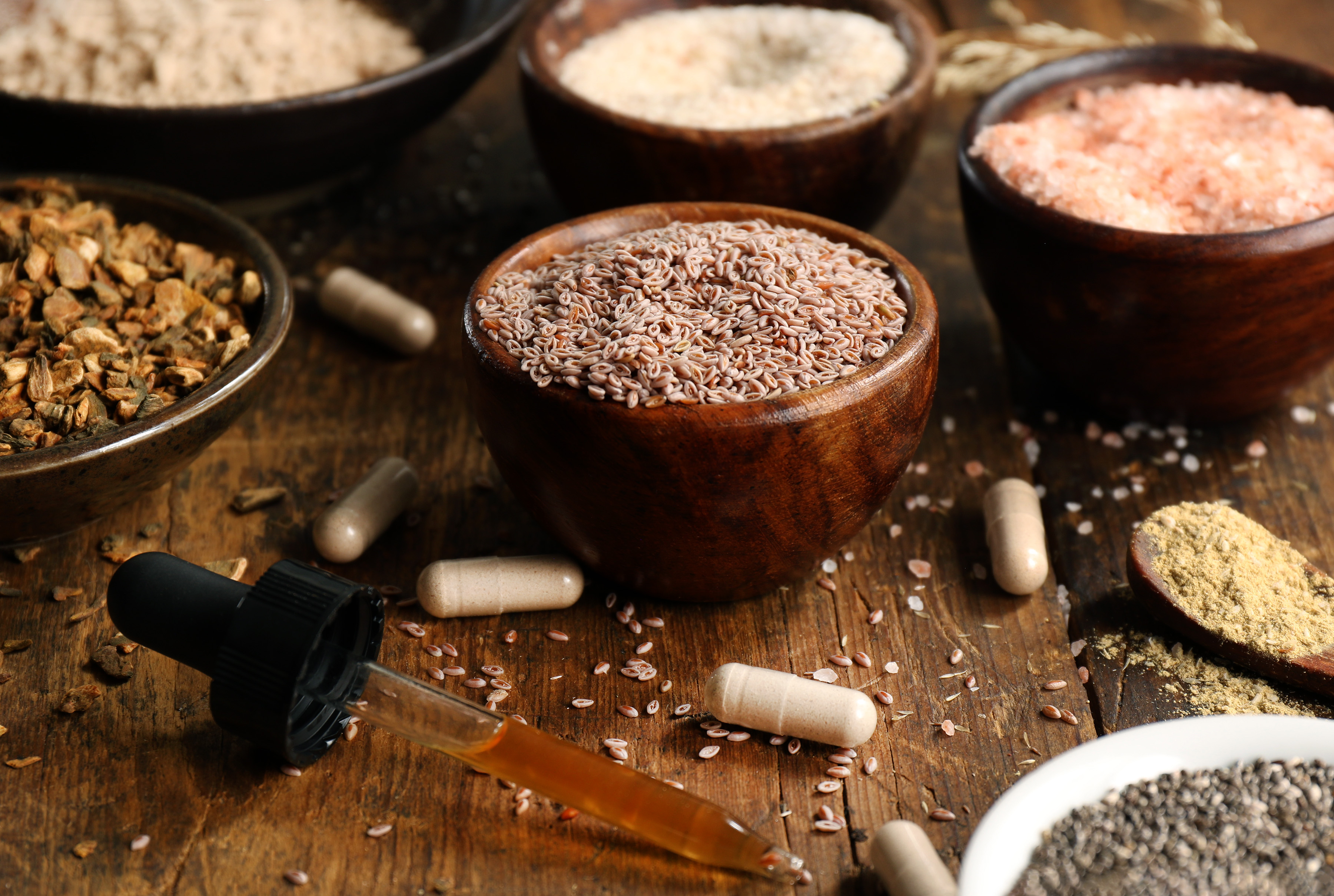 A variety of herbs used for digestion and gentle laxative properties include slippery elm bark, cascara sagrada bark, psyllium seeds, Himalayan pink salt, and triphala powder.