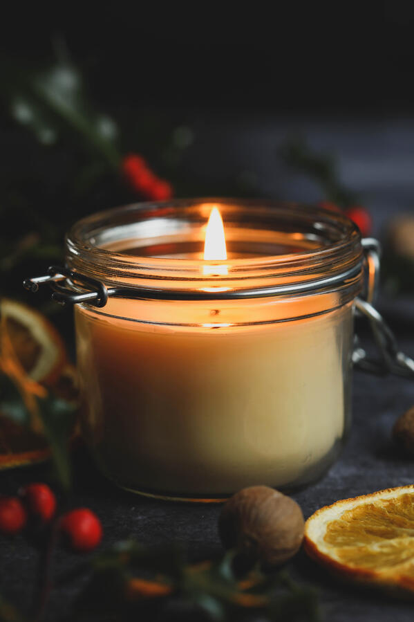 DIY spiced cream beeswax candle burning in a jar