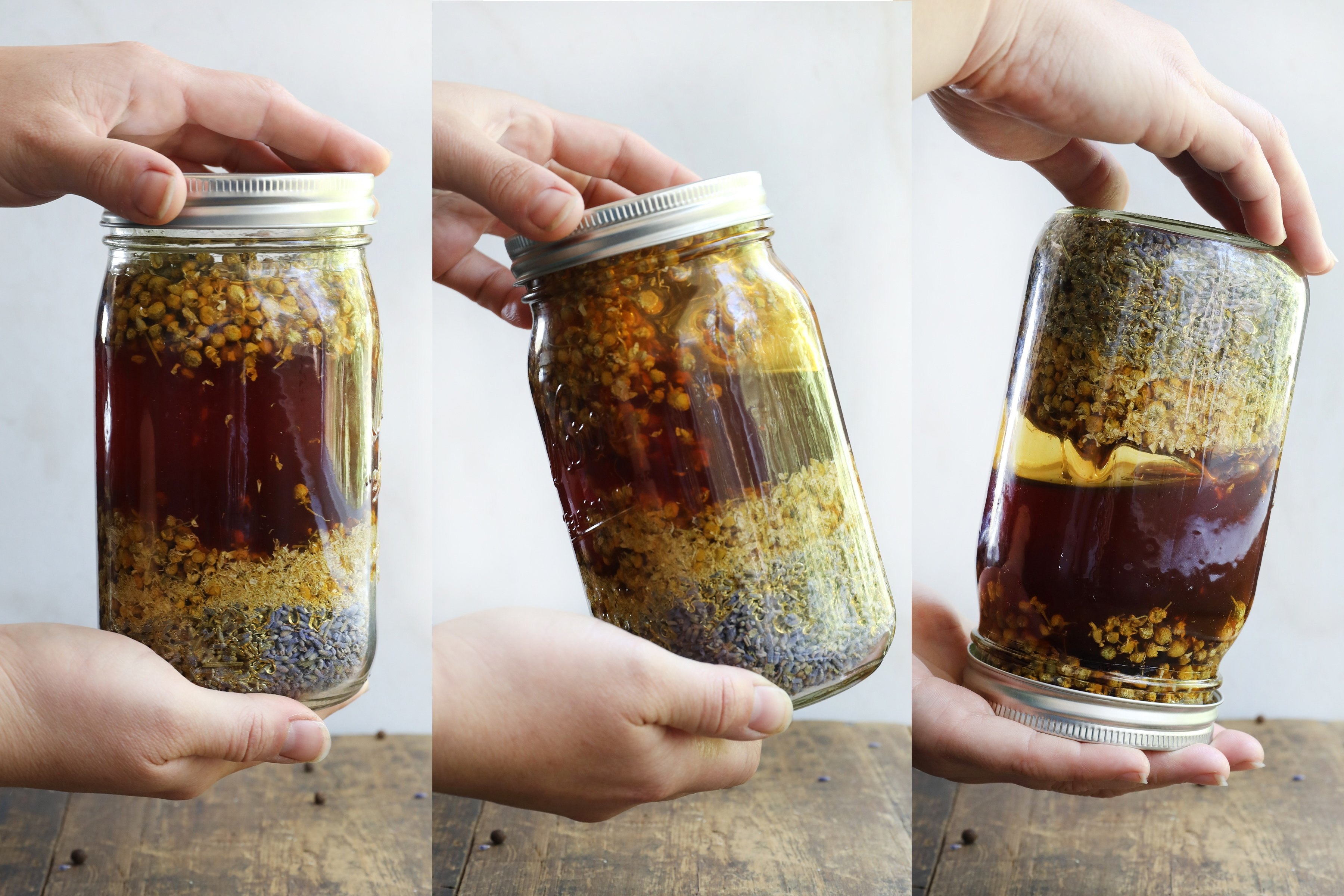 Hands flipping mason jar to mix honey and herbs