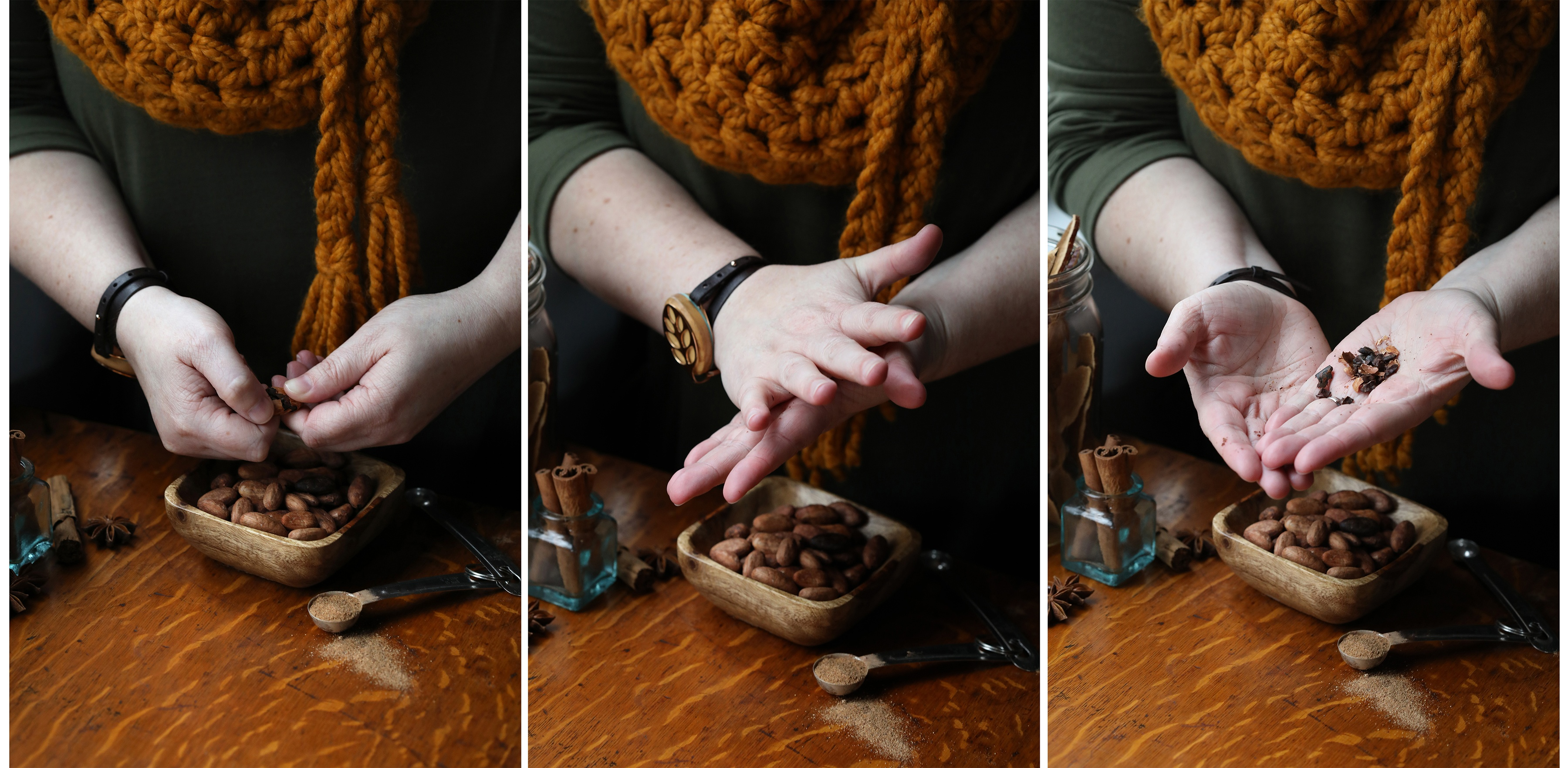 Hands rubbing and crushing whole cacao beans