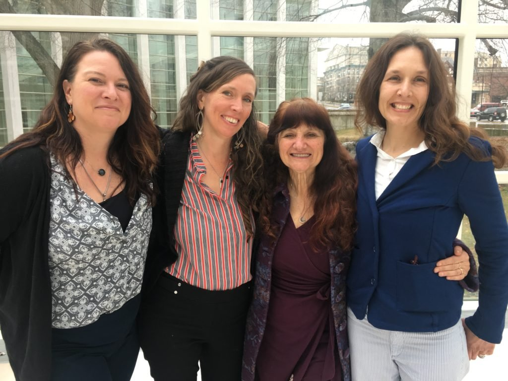 Rosemary Gladstar, Nicole Telkes, Kathi Langelier, and Mary Blue huddle together after trials over trademark of Fire Cider took place in Springfield, Massachusetts.