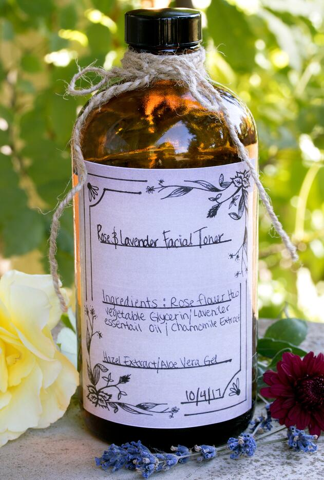Bottle of Rose Flower toner with handmade label sitting outside