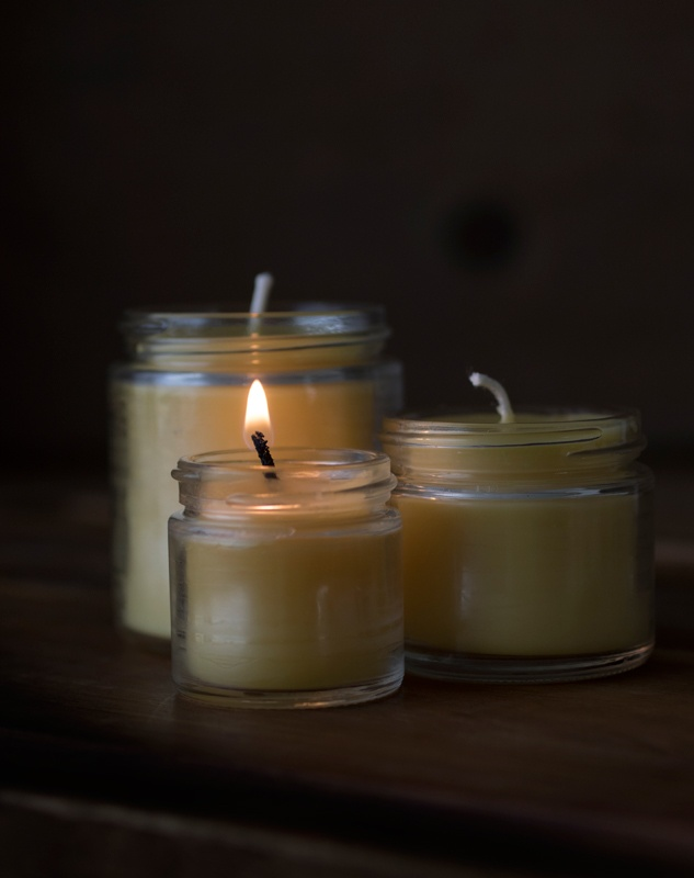Burning candle in set of three
