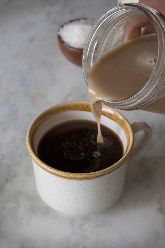 Homemade Creamer Pouring into Cup of Coffee