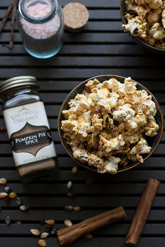Chipotle honey caramel corn on black table with ingredients spread out