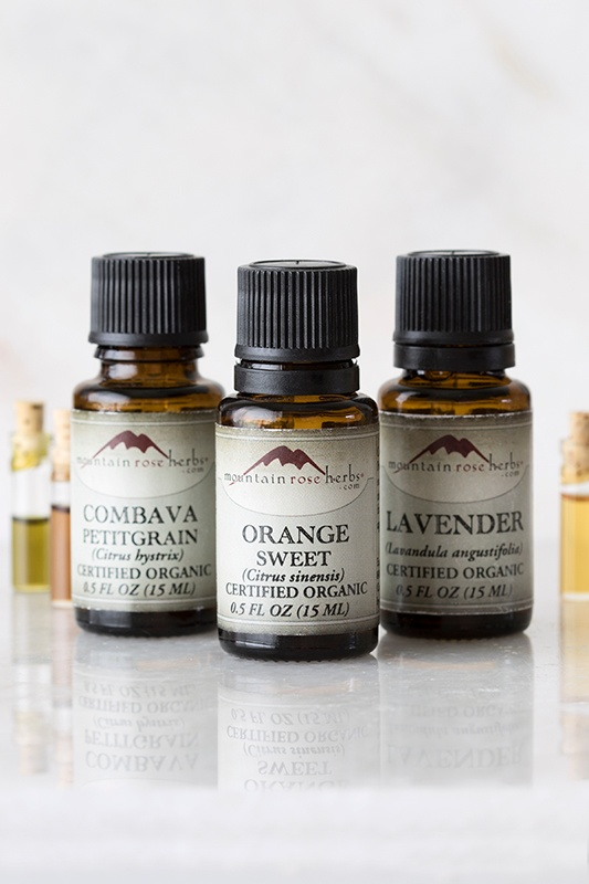 Organic Essential Oils In Triangle Formation