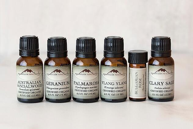 1/2 ounce bottles of certified organic essential oils lined up with their labels out