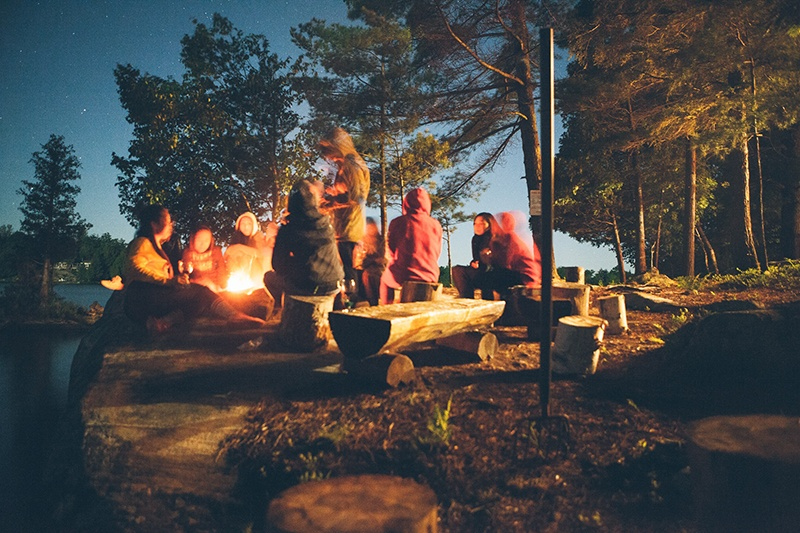 Family and friends camping outdoors