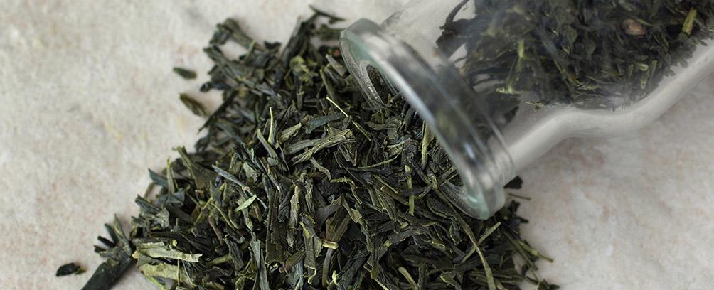 Green Tea Spilling from bottle