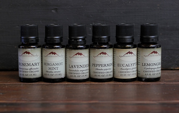 Six essential oil bottles in a line