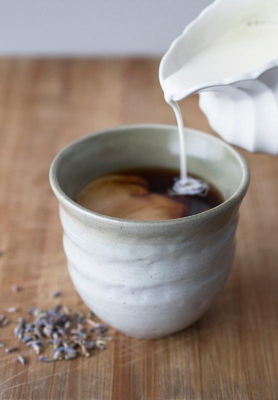 Milk pouring into lavender earl grey latte