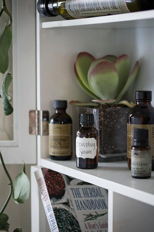 DIY Skin Serum in glass bottle on shelf