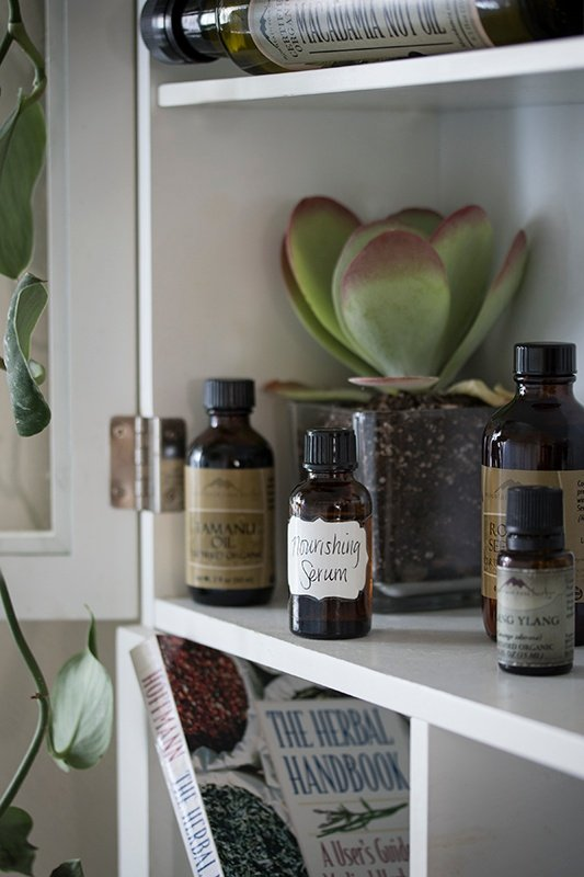 DIY Skin Serum in glass bottle on shelf