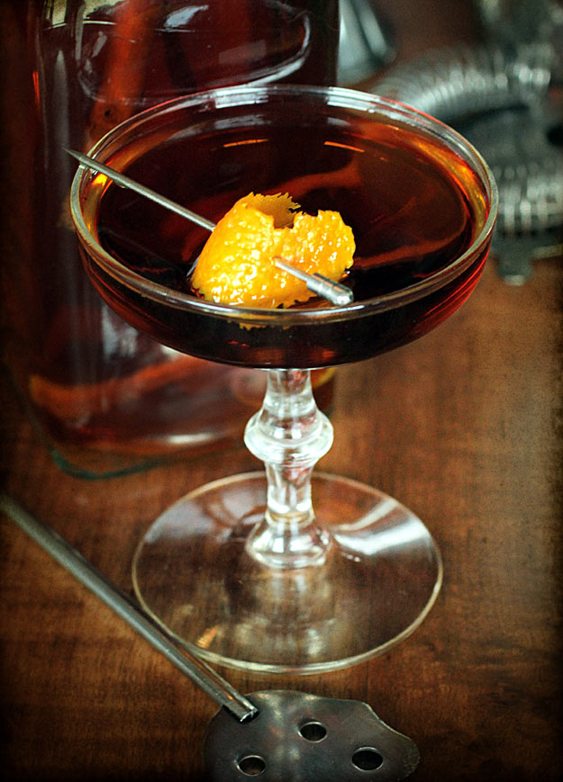 Orange Spice Manhattan with Orange Peel Garnish on tabletop