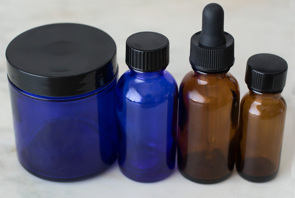 amber and blue cobalt empty containers for DIY recipes