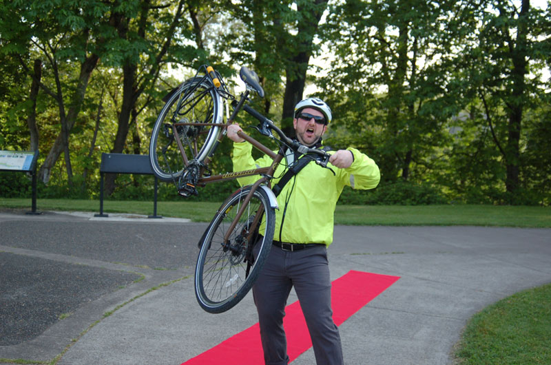 Cyclist from the Fashion Show Poses With Bike