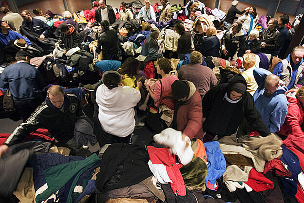 Many people donating and sorting through clothes for Buy Nothing Day