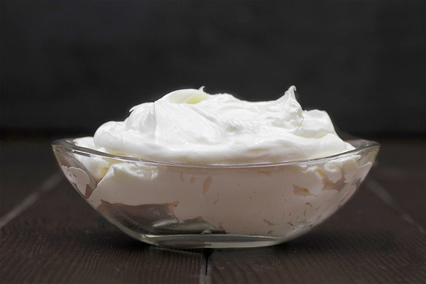 whipped body butter recipe made with shea oil in bowl on black background