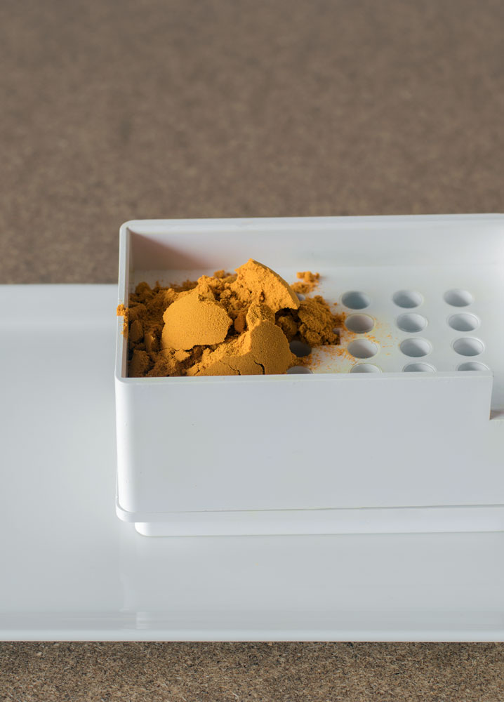 Organic turmeric powder ready for making into herbal capsules