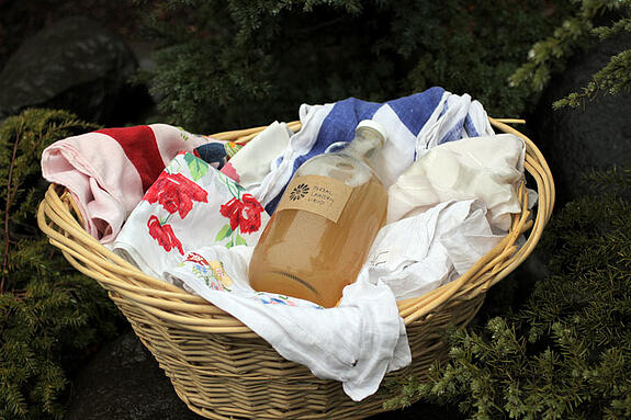 Homemade laundy detergent in laundry basket