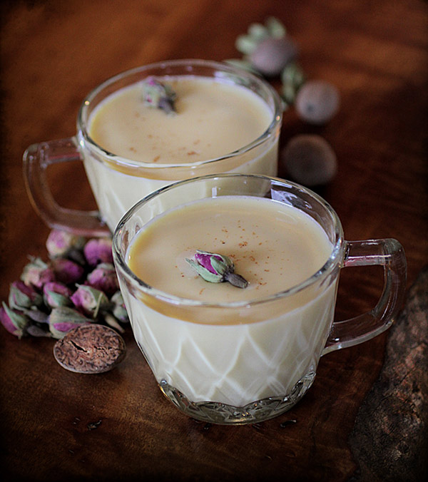 Rose and Cardamom Egg Nog in Antique Glass Mug on Tabletop