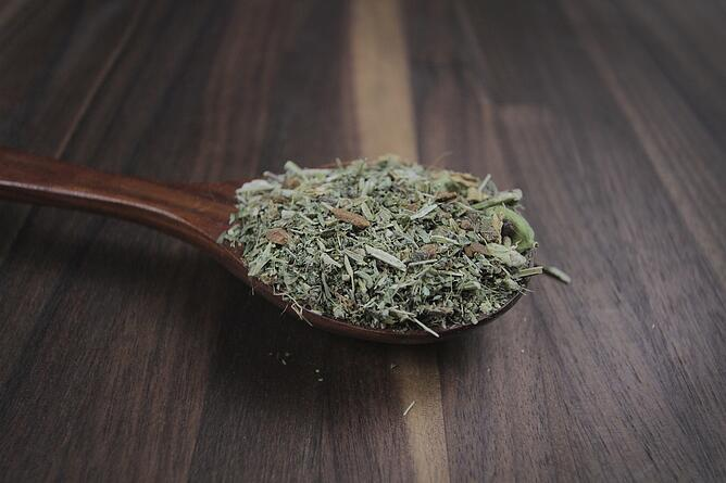 Herbs on wooden spoon for herbal infusion