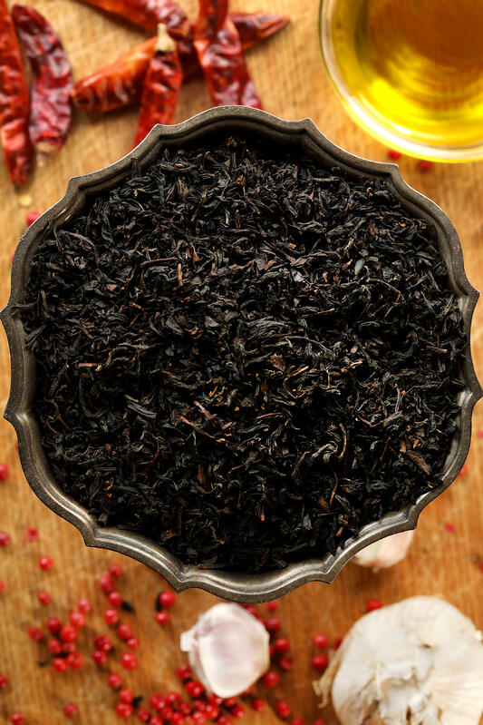 Lapsang souchong is a smoked black tea that can be used in culinary recipes like infused cooking oil or simple syrup. Black tea pairs well with warming, earthy flavors like black pepper, garlic, and chilis.