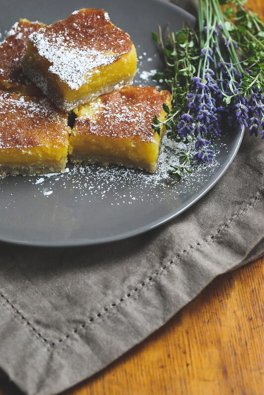 Lemon lavender bars on plate with lavender flowers