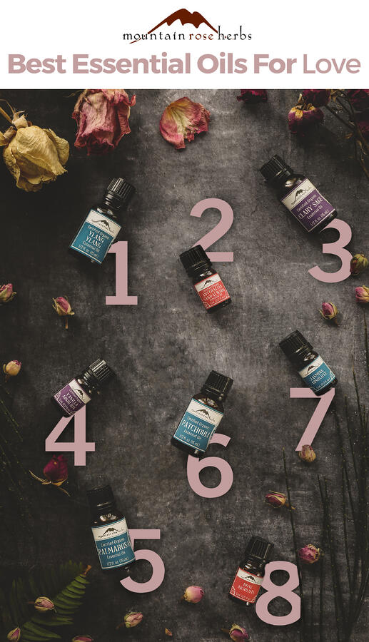 Seven essential oils for love laid out on a table.