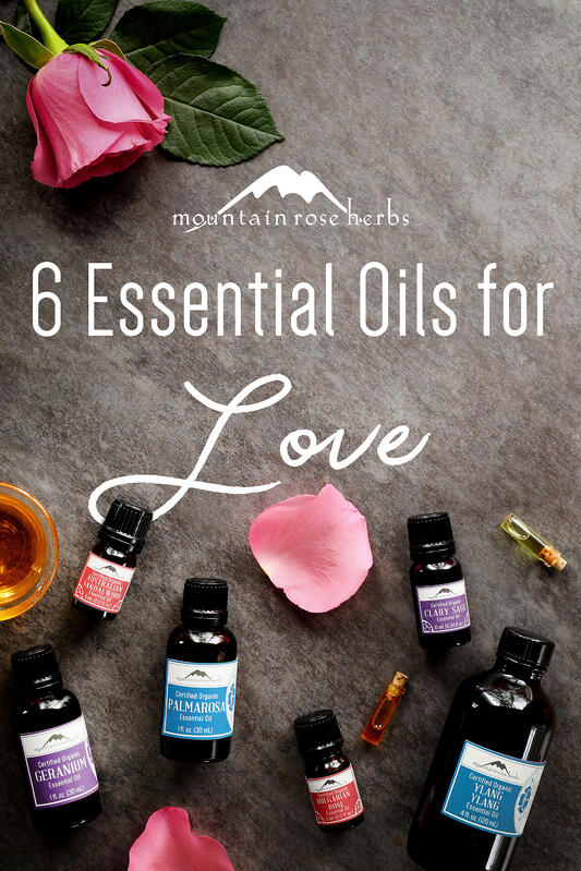 Essential oils for love include geranium essential oil, Austrailian sandalwood, ylang ylang, palmarosa, bulgarian rose, and clary sage.